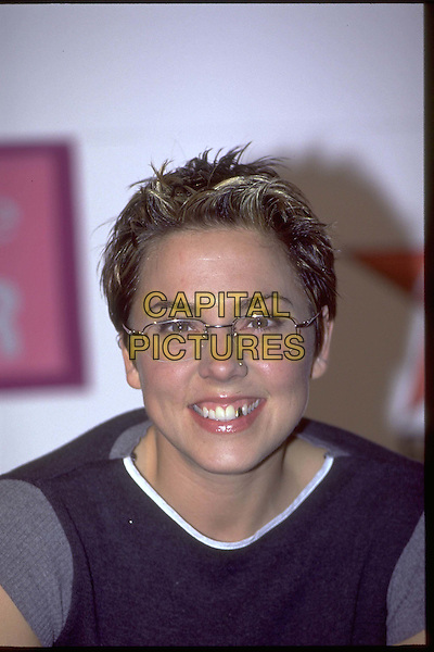 MEL C - SPICE GIRLS.Ref: 9077.short cropped hair, glasses, spectacles, sporty spice, tomboy, gold tooth , headshot, portrait.*RAW SCAN - photo will be adjusted for publication*.www.capitalpictures.com.sales@capitalpictures.com.© Capital Pictures