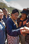 Mbah Maridjan is warmly greeted by revellers following a ceremony to appease the Merapi spirits following a 2006 eruption.