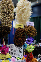 Wigs with curls are for sale in 28 colors and many styles at the 2013 World Championships for Irish Dancing in Boston, Massachusetts, USA.  The 2013 competition in Boston is the second time in the competition's 43-year history that the event has been held in the United States.