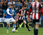 Gary Hooper of Sheffield Wednesday and Jake Wright of Sheffield Utd  during the Championship match at the Hillsborough Stadium, Sheffield. Picture date 24th September 2017. Picture credit should read: Simon Bellis/Sportimage