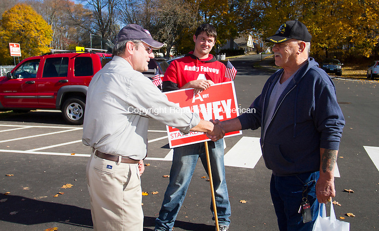 CHESHIRE, CT - 08 NOVEMBER 2016 - 110816JW04.jpg -- As his son Joe Falvey looks on, Republican Candidate for Connecticut State Representative 103 District Andy Falvey shakes the hand of supporter Don Whipple of Cheshire during voting at Dodd Middle School Tuesday afternoon.     Jonathan Wilcox Republican-American
