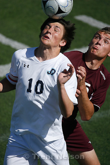 Trent Nelson  |  The Salt Lake Tribune.Juan Diego's Skyler Doran and Morgan's Brennan West leap for the ball as Juan Diego defeats Morgan High School boys soccer 7-0 in Draper, Utah, Thursday, May 5, 2011.