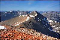 This Colorado image was taken in the Rocky Mountains about 16 miles outside of Lake City. Standing on the summit of Red Cloud Peak, at 14,034 feet, you can see the summit of Sunshine Peak just 1.5 miles away standing at 14,001 feet. It is an easy walk over, but you have to leave early enough to avoid the afternoon storms. My hiking buddy and I left camp at 4:30am. We were the first ones up and the first ones down. As we walked into camp nearly 8 hours later, the lightening, rains and hail came. Unfortunately, there were more than several groups still up on the slopes.