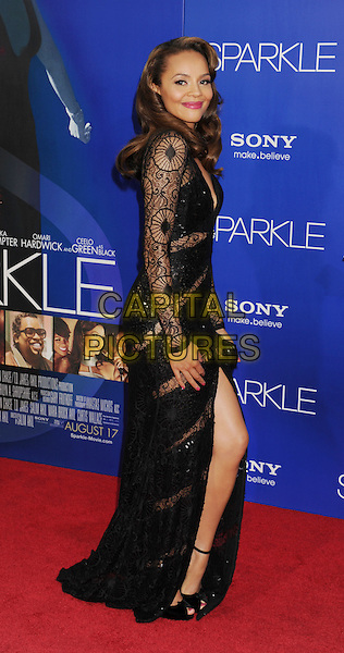 "Carmen Ejogo.arriving at the Los Angeles premiere of ""Sparkle"" at Grauman's Chinese Theatre in Hollywood, California, USa, .August 16th, 2012..full length black lace dress long sleeve long maxi slit split side .CAP/ROT/TM.©Tony Michaels/Roth Stock/Capital Pictures"