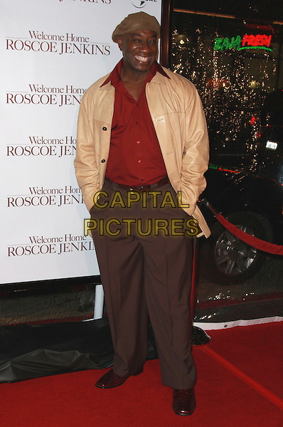 """MICHAEL CLARKE DUNCAN.""""Welcome Home Roscoe Jenkins"""" Premiere held at Grauman's Chinese Theatre, Hollywood, California, USA..January 28th, 2008.full length beige leather jacket brown flat cap hat red shirt trousers hands in pockets.CAP/ADM/CH.©Charles Harris/AdMedia/Capital Pictures."""