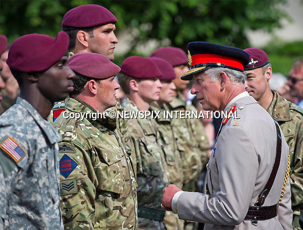 05.06.2014; Normandy, FRANCE: PRINCE CHARLES<br /> presenting soldiers from the Parachute Regiment with French Airborne Wings for completing jump training in France<br /> He attended a parade in Breville-les-Monts after watching Parachutists landing on a Drop Zone as part of the D-Day remembrance services.<br /> The Prince of Wales is Colonel in Chief of The Parachute Regiment.<br /> Mandatory Credit Photo: &copy;Peters-Crown Copyright/NEWSPIX INTERNATIONAL<br /> <br /> **ALL FEES PAYABLE TO: &quot;NEWSPIX INTERNATIONAL&quot;**<br /> <br /> IMMEDIATE CONFIRMATION OF USAGE REQUIRED:<br /> Newspix International, 31 Chinnery Hill, Bishop's Stortford, ENGLAND CM23 3PS<br /> Tel:+441279 324672  ; Fax: +441279656877<br /> Mobile:  07775681153<br /> e-mail: info@newspixinternational.co.uk