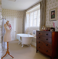 The main bathroom features a free-standing roll-top bath and the curtains are dyed antique linen sheets.
