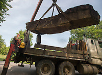 NWA Democrat-Gazette/J.T. WAMPLER Mark Caldwell of Fayetteville uses a truck-mounted crane to deliver a rock weighing more than two tons to a site in south Fayetteville Thursday July 5, 2018. Rocks weighing up to five tons are being used in a rock sculpture garden on Stirman Ave. near the Town Branch Trail.