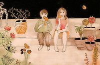 Boy and girl in garden eating popsicle