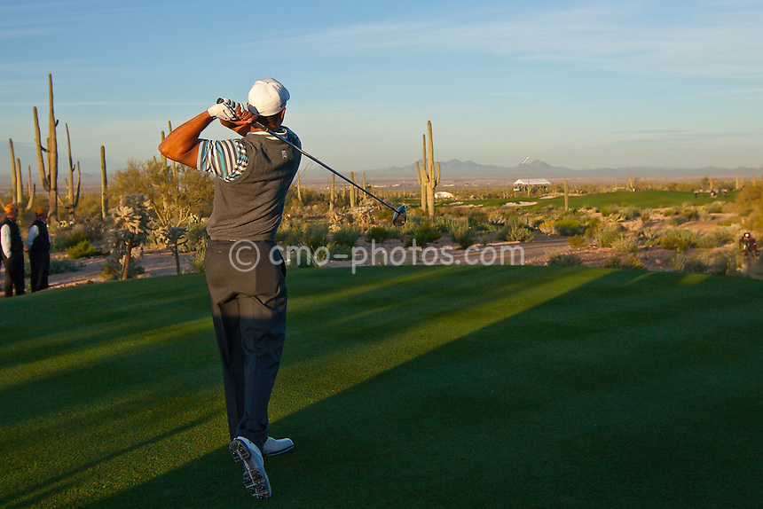 Feb 24, 2009; Marana, AZ, USA; Tiger Woods (USA) hits his tee shot on the 2nd hole during a Tuesday practice round prior to the World Golf Championships-Accenture Match Play Championship at the Ritz-Carlton Golf Club, Dove Mountain.