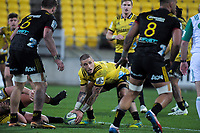 TJ Perenara passes from a ruck during the Super Rugby quarterfinal match between the Hurricanes and Chiefs at Westpac Stadium in Wellington, New Zealand on Friday, 20 July 2018. Photo: Dave Lintott / lintottphoto.co.nz