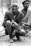 A Turkana man in a village near Kakuma in Northern Kenya.<br />  He wears a circular knife on his wrist which he uses  for cutting meat and skins and combat.