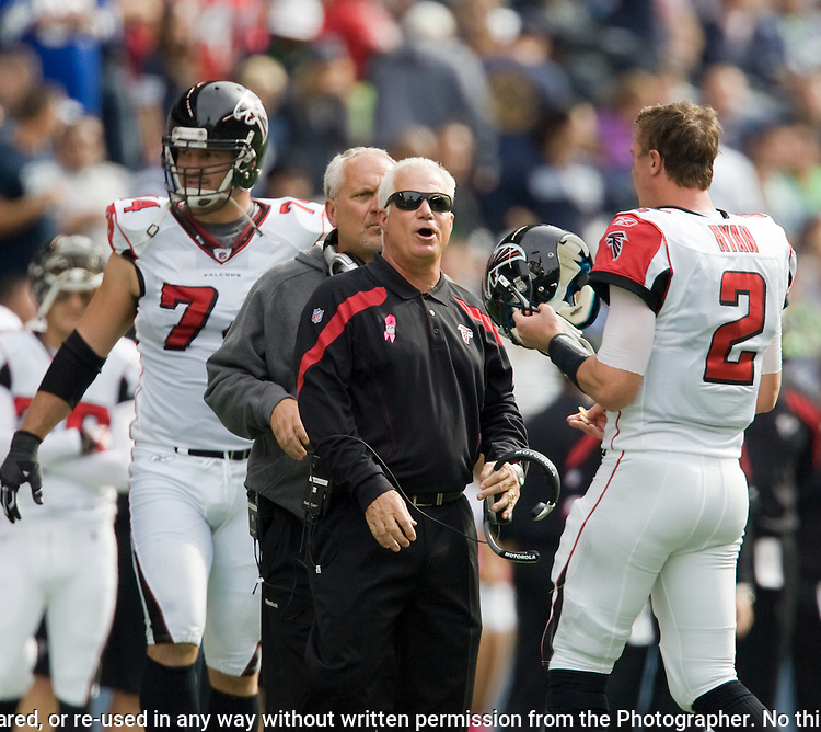 Atlanta Falcons head coach Mike Smith talks to quarterback MAtt Ryan during a change of possession at CenturyLink Field in Seattle, Washington on October 2, 2011. The Falcons beat the Seahawks 30-28 . ©2011 Jim Bryant Photo. All Rights Reserved.