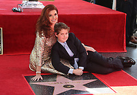 HOLLYWOOD, CA - October 06: Debra Messing, Roman Zelman, At Debra Messing Honored With Star On The Hollywood Walk Of Fame At On The Hollywood Walk Of Fame In California on September 06, 2017. <br /> CAP/MPI/FS<br /> &copy;FS/MPI/Capital Pictures