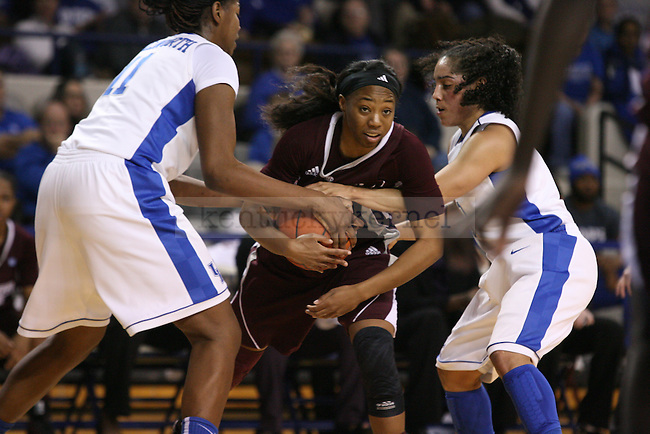 UK junior center DeNesha Stallworth (left) and sophomore point guard Jennifer O'Neill (right) block a Mississippi State player at Memorial Coliseum on Thursday, January 17, 2013 in Lexington, Ky.  Photo by Adam Pennavaria | Staff
