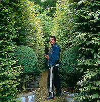 Nicholas Haslam in the garden of his English country home