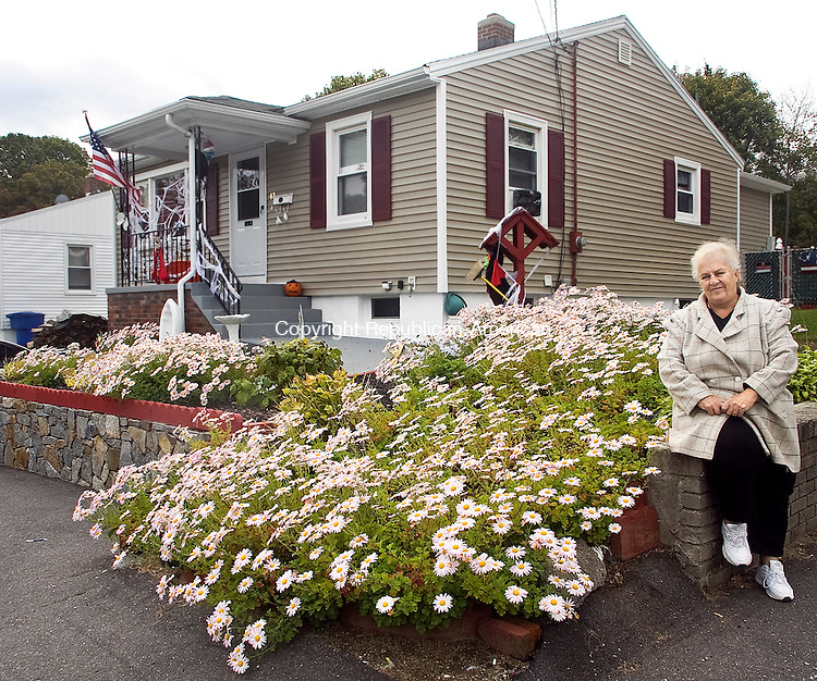 WATERBURY CT.-20 OCTOBER 2010 102010DA01- Maryann Hailstones of Waterbury sits by her daisies in front of her yard that are now in full bloom. Hailstones won a city beautification award for her landscaping. <br /> Republican-American   Darlene Douty