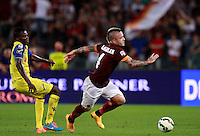 Calcio, Serie A: Roma vs ChievoVerona. Roma, stadio Olimpico, 18 ottobre 2014.<br /> Roma's Radja Nainggolan is chased by Chievo Verona's Isaac Cofie, left, during the Italian Serie A football match between Roma and ChievoVerona at Rome's Olympic stadium, 18 October 2014.<br /> UPDATE IMAGES PRESS/Isabella Bonotto