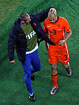 John Heitenga (3) is being comforted by teammate after he received red card, Soccer, Football - 2010 FIFA World Cup - Johannesburg, South Africa, Sunday, July, 11, 2010. Final match, Netherlands vs Spain, Soccer City Stadium (credit & photo: Pedja Milosavljevic / +381 64 1260 959 / thepedja@gmail.com / STARSPORT )