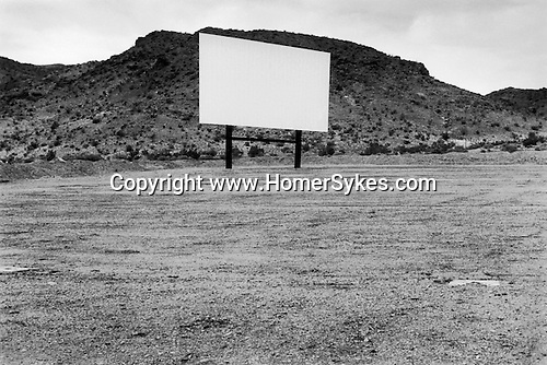 BARSTOW, CALIFORNIA - USA  JUNE 2001: AN EMPTY DRIVE IN MOVIE THEATRE WITH GIANT WHITE CINEMA SCREEN.