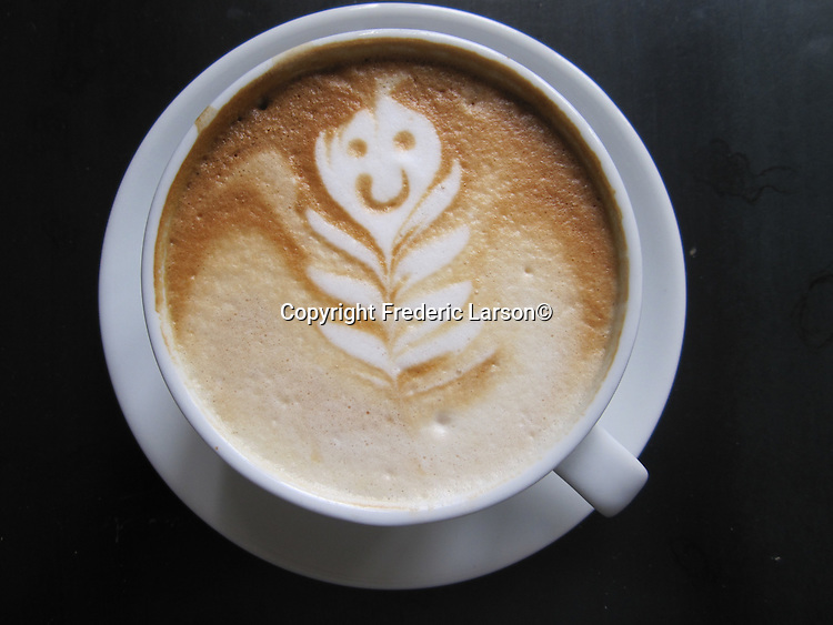 "A fancy cappuccino with a happy face was made by ""Ross"" at the Dish restaurant in Mill Valley California."
