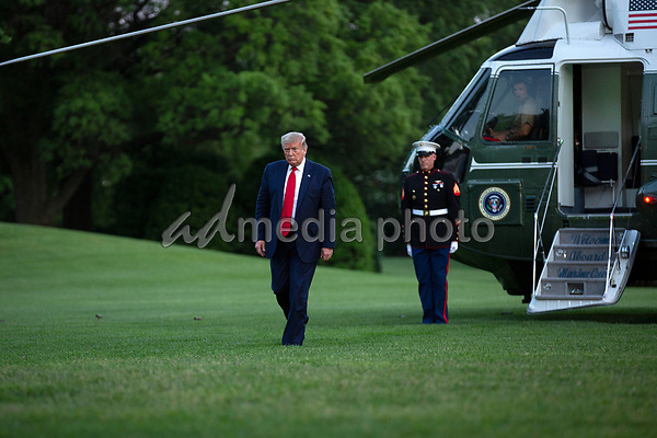 """United States President Donald J. Trump walks on the South Lawn of the White House in Washington, D.C., U.S., as he arrives from the Kennedy Space Center in Florida on Saturday, May 30, 2020.  Trump vowed his administration would end what he called """"mob violence"""" in U.S. cities following the death of an unarmed black man at the hands of Minnesota police, blaming leftist groups for clashes with police and property damage around the nation. <br /> Credit: Stefani Reynolds / Pool via CNP/AdMedia"""