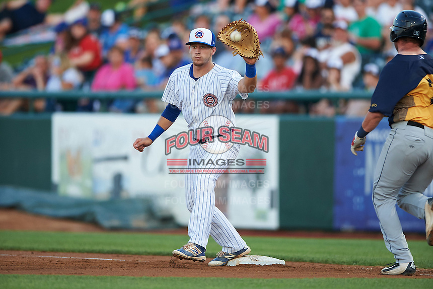 South Bend Cubs first baseman P.J. Higgins (7) stretches for a throw during a game against the Burlington Bees on July 22, 2016 at Four Winds Field in South Bend, Indiana.  South Bend defeated Burlington 4-3.  (Mike Janes/Four Seam Images)
