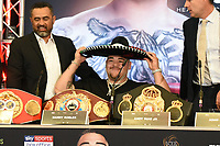 Andy Ruiz Jr puts on a Mexican hat during a Press Conference at Hilton London Syon Park on 6th September 2019