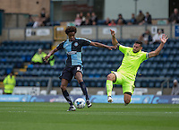 Billy Paynter of Hartlepool United jumps it to attempt a tackle on Sido Jombati of Wycombe Wanderers during the Sky Bet League 2 match between Wycombe Wanderers and Hartlepool United at Adams Park, High Wycombe, England on 5 September 2015. Photo by Andy Rowland.
