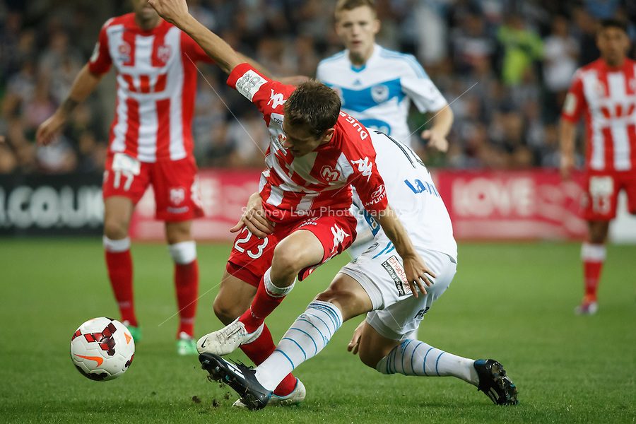Mate DUGANDZIC of the Heart is held by James TROISI of the Victory in the round 21 match between Melbourne Heart and Melbourne Victory in the Australian Hyundai A-League 2013-24 season at AAMI Park, Melbourne, Australia. Photo Sydney Low/Zumapress<br /> <br /> This image is not for sale on this web site. Please visit zumapress.com for licensing