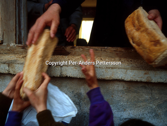 Ethnic Albanian refugees from Kosovo queuing for bread handouts on April 6, 1999, Kukes, Albania. Hundreds of thousands of people fled into Macedonia and Albania during the Serb terror of Kosovo..Photo: Per-Anders Pettersson/ iAfrika Photos