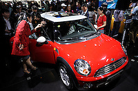 Mini Cooper at the Auto China 2008 in Beijing. The car show has attracted all the world's major auto markers. Vehicle production and sales both surged more than 20 percent to a record 8.8 million units in China last year. Analysts forecast that both China's auto output and sales will continue to expand at double-digit rates in 2008 to 10 million as the economy grows rapidly and the government tries to encourage people to spend money..24 Apr 2008