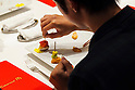 A customer enjoys eating a McDonald's special dinner created by chef Masayo Waki during a ''Restaurant M'' event in the posh Roppongi Hills area on July 27, 2015, Tokyo, Japan. 20 chosen diners (from 8,300 applications) ate a special multi-course dinner created by the celebrity chef using ingredients from the restaurant chain's regular menu. The special one-night only event was organized to celebrate the launch of its new summer menu ''Fresh Mac,'' which features fresh vegetables. The five-course meal served on a white tablecloth with plates and proper cutlery included a Vichyssoise en Pommes de terre de McDonald, Mousse au Poivron Rouge, Salade en Gelee aux Legumes de McDonald, Cinq Pinchos des McDonald Patties avec leur Sauces, a choice of main dish including the Fresh Mac Bacon Lettuce Burger, and a McFlurry Mixed Berry Oreo dessert with a Premium Roast Coffee. (Photo by Rodrigo Reyes Marin/AFLO)