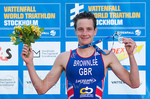 25 AUG 2013 - STOCKHOLM, SWE - Alistair Brownlee (GBR) of Great Britain celebrates winning the men's ITU 2013 World Triathlon Series round in Gamla Stan, Stockholm, Sweden (PHOTO COPYRIGHT © 2013 NIGEL FARROW, ALL RIGHTS RESERVED)
