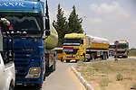 Egyptian trucks carrying fuel arrive to Gaza's power plant in Nusseirat, in the central Gaza Strip after entering the southern Gaza Strip from Egypt through the Rafah border crossing on June 21, 2017. Egypt began to deliver a million litres of fuel to Gaza, a Palestinian official said, in an attempt to ease the Palestinian enclave's desperate electricity crisis. The fuel, trucked in through the Rafah border between Egypt and Gaza, will be routed to the territory's only power station -- closed since April due to fuel shortages. Photo by Ashraf Amra