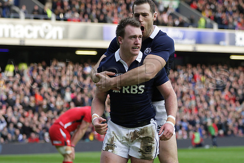 15.02.2015.  Edinburgh, Scotland. 6 Nations Championship. Scotland versus Wales. Scotland's Tim Visser congratulates Scotland's Stuart Hogg after his try.