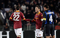Calcio, semifinale di andata di Coppa Italia: Roma vs Inter. Roma, stadio Olimpico, 23 gennaio 2013..AS Roma forward Mattia Destro, left, is congratulated by teammate Francesco Totti past FC Inter defender Javier Zanetti, of Argentina, right, during the Italy Cup football semifinal first half match between AS Roma and FC Inter at Rome's Olympic stadium, 23 January 2013..UPDATE IMAGES PRESS/Riccardo De Luca