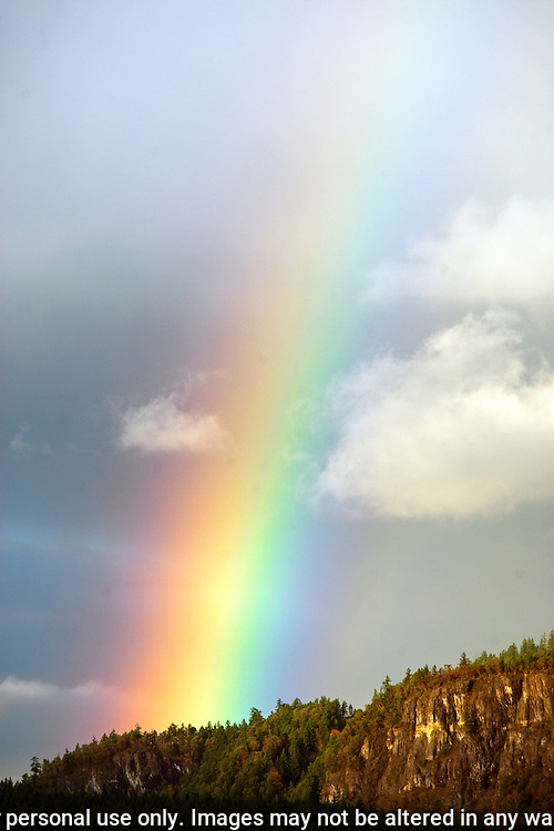 Rainbow streams through the cloud cover near Eatonville, WA.  Jim Bryant Photo. ©2015. All Rights Reserved.