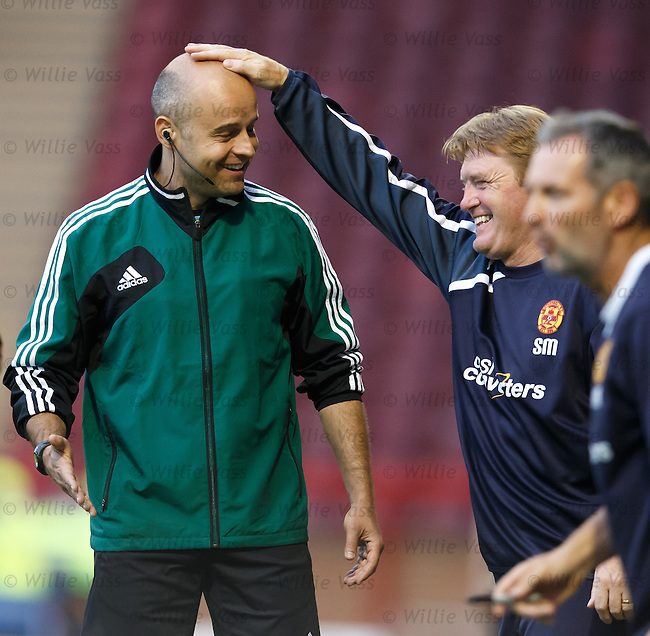 Stuart McCall jokes with the 4th official