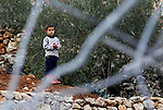 A Palestinian boy stands next to the rubble of two under-construction Palestinian residential buildings after they were demolished by Israeli bulldozers in the West Bank town of Biet Jala, near Bethlehem January 29, 2018. Photo by Wisam Hashlamoun