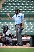 Umpire Thomas O'Neil signals to play ball behind catcher Alexander Alvarez during a game between the GCL Rays and GCL Orioles on July 21, 2017 at Ed Smith Stadium in Sarasota, Florida.  GCL Orioles defeated the GCL Rays 9-0.  (Mike Janes/Four Seam Images)