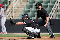 Kannapolis Intimidators catcher Casey Schroeder (17) sets a target as home plate umpire Mark Bass looks on during the game against the Hagerstown Suns at Kannapolis Intimidators Stadium on June 15, 2017 in Kannapolis, North Carolina.  The Intimidators walked-off the Suns 5-4 in game one of a double-header.  (Brian Westerholt/Four Seam Images)