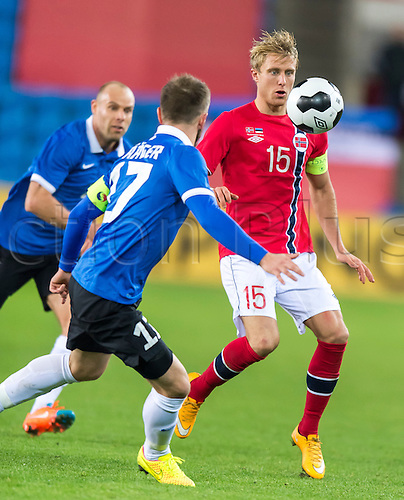 12.11.2014 Oslo, Norway  Enar Jaager of Estonia  (L)  battles with  Per Ciljan Skjelbred of Norway (R) during the international friendly match  between Norway and Estonia at the Ullevaal Stadion in Oslo, Norway