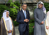United States President Barack Obama delivers remarks alongside Kuwaiti Emir Sheikh Sabah Al-Ahmad Al-Sabah (L) and Qatar's Emir Sheikh Tamim bin Hamad Al-Thani, following the Gulf Cooperation Council-U.S. summit at Camp David on May 14, 2015. Obama hosted leaders from Saudi Arabia, Kuwait, Bahrain, Qatar, the United Arab Emirates and Oman to discuss a range of issues including terrorism and the U.S.-Iran nuclear deal. <br /> Credit: Kevin Dietsch / Pool via CNP