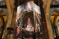 BNPS.co.uk (01202 558833)<br /> Pic: ZacharyCulpin/BNPS<br /> <br /> Pictured:  Photographer Ash Mills and Salisbury Cathedral curator Jacquiline Creswell admire the nativity.<br /> <br /> One of the UK's most historic cathedrals today unveiled a 40ft Renaissance-style photographic tableau as its nativity - with its very own clergy, volunteers and staff starring as figures from the Christian scene.<br /> <br /> Salisbury Cathedral's spectacular nativity features its stonemason as Joseph, a bookings agent as Mary, a retired postman as a shepherd, a Canon and guides as Wise Men - and the son of an ex-England rugby player as baby Jesus.<br /> <br /> The Wiltshire cathedral wanted to put a modern twist on the traditional Christmas scene and cast people as Nativity characters before holding a series of individual and group photoshoots.