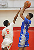 Moses Brown #24 of Archbishop Molloy, right, shoots over Deven Williams #5 of Half Hollow Hills West during a varsity boys' basketball game at Long Island Lutheran High School on Sunday, Jan. 3, 2016. Archbishop Molloy defeated Hills West by a score of 70-56.