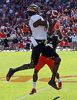 Maryland Terrapins wide receiver Kevin Dorsey (12) makes a catch next to Virginia Cavaliers cornerback Drequan Hoskey (22) during the game at Scott Stadium in Charlottesville, VA. Photo/The Daily Progress/Andrew Shurtleff