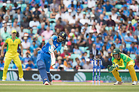 Shikhar Dhawan (India) drives over extra cover one bounce for four during India vs Australia, ICC World Cup Cricket at The Oval on 9th June 2019