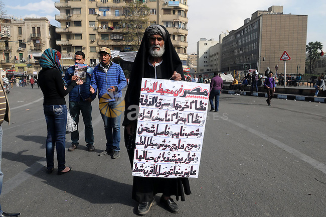An Egyptian protester holds a placard during an anti-government demonstration in Cairo's landmark Tahrir square on February 26, 2013. Photo by Tarek al-Gabas