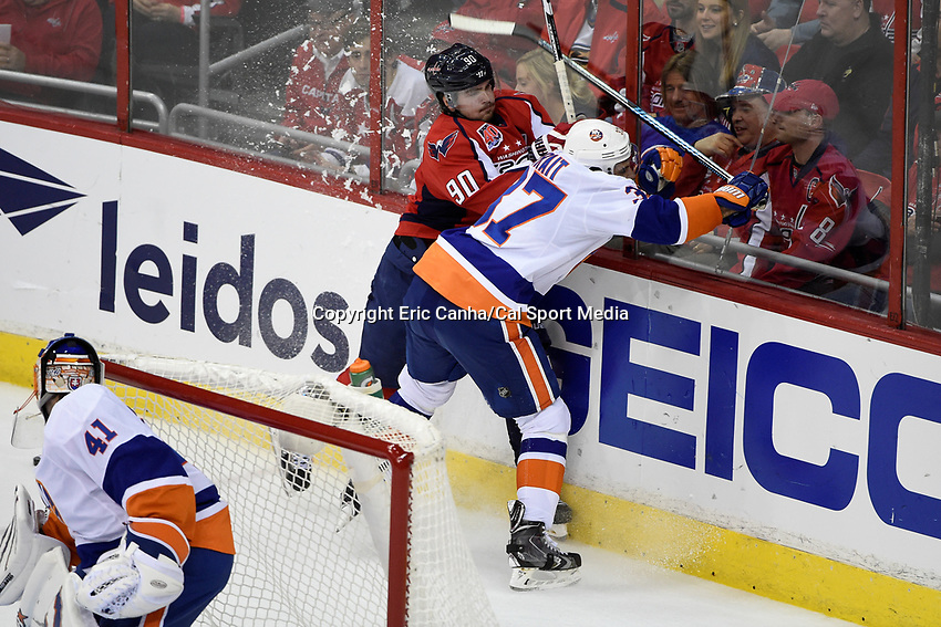 April 23, 2015 - Washington D.C., U.S. - Washington Capitals left wing Marcus Johansson (90) and New York Islanders defenseman Brian Strait (37) hit the boards during game 5 of the  NHL Eastern Conference Quarter finals between the New York Islanders and the Washington Capitals held at the Verizon Center in Washington DC.